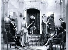Wealthy clients are watching a private haute couture show at fashion ...