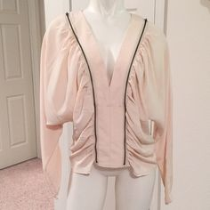 Silk zippered blouse NWOT Very flattering silk blouse with zippered detail. Cinches in around the waist and neck. Never before worn- no tags Victoria's Secret Tops Blouses