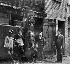 Lewis Hine - 11:00 A.M. Newsies at Skeeter's Branch. They were all smoking. St. Louis, Mo., May 9, 1910