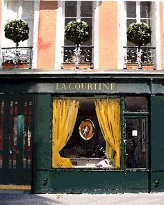 Paris Storefront..love the idea of these topiarys on the balcony of the apartment above the storefront.