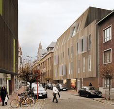 a2o architecten: wooden facade acts as outer shell
