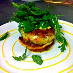 Mouth-watering jumbo lump crab cake at Beach Walk Cafe at Henderson Park Inn. Pan-roasted, it sits atop a corn and scallion griddle cake, is garnished with organic baby arugula, and is served with lemon aioli. Henderson Park, Coast Restaurant, Baby Arugula, Griddle Cakes, Destin Florida, Roasting Pan, Crab Cakes, Beach Walk