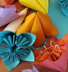 Here's a DIY idea that will keep you on budget while having a unique touch. Wedding origami flower favors