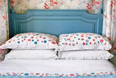 DIY Linens: Rather than overpower a pretty pastel color scheme, simple white linens enliven rose-colored floral with some additional iron-on patches. A patchwork of similar patterns and colors tie the room together and add new life to otherwise basic bedding. Here, newly polka-dotted pillow shams match nicely with a periwinkle headboard.