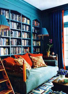 turquoise library / study / bookcase with lamps and sofa to match - a delightfully colorful reading nook