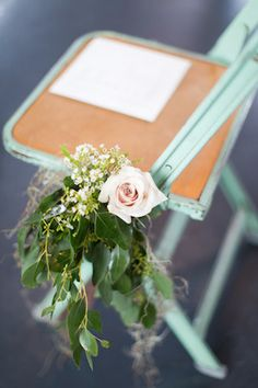 Rose adorned mint wedding ceremony chairs | Melissa Kruse Photography and Diana Tsao Events | see more on: http://burnettsboards.com/2014/08/bubble-wedding/