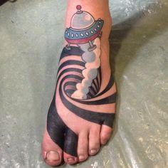 15 Hypnotizing Space Illusion Tattoos