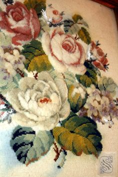 Antique needlepoint. Love how the flowers are fluffy and stands out