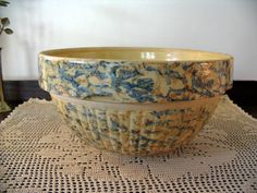 Produced by red wing union potteries 1906-1936 my favorite, Saffron ware, a warm yellow with blue and rust sponging.  I love them !
