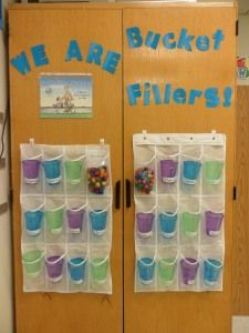 My DIYed version of bucket filling using plastic cups and a hanging shoe organizer.