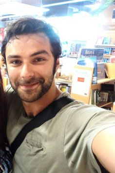 Aidan Turner ~ He's taking a picture for somebody...wish it was me.