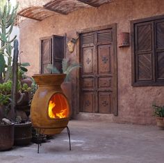 Maya BBQ chimenea in front of a classical Mexican hacienda. Love the dark wood on stucco