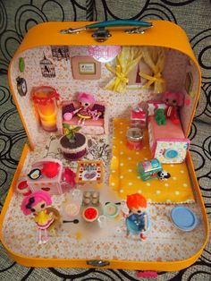 DIY Lalaloopsy dollhouse:  Close-up pictures & materials list to make each item.  Made from a lunch box.  Scrappalific