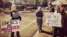 Grayson and Tina Haver Currin's Counter-Protest to Abortion Clinic Picketers Is the Stuff of Genius