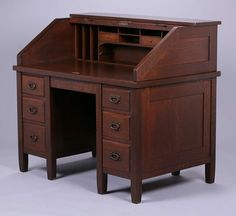 Extremely rare – Gustav Stickley 48″w roll-top desk with six drawers.  Unsigned.  Very nicely refinished.