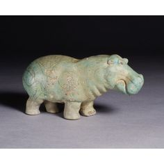 Hippopotamus Egyptian Middle Kingdom (2161–1640 BC) Dynasty 13 (1783–1640 BC) faience This figure of a hippo was molded in faience, a crushed quartz glazed and fired at a relatively low temperature. Copper salts in the glaze impart the bright blue or blue-green color so characteristic of faience objects. Over the animal's naturalistic shape, the craftsman painted lily plants that appear as a giant tattoo.Saint Louis Art Musuem