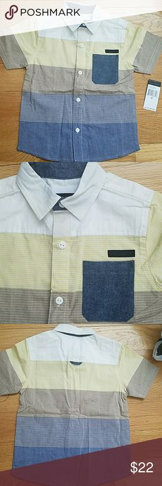 Boys Sean John button up shirt 100% cotton solid and yarn dyed short sleeve shirt with logo buttons.  Denim collar lining, pocket and back loop. Yellow taping on inside placket. Sean John Shirts & Tops Button Down Shirts