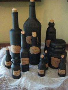 Witches Potion Bottles - Jars & bottles spray painted black with tea stained paper bag labels