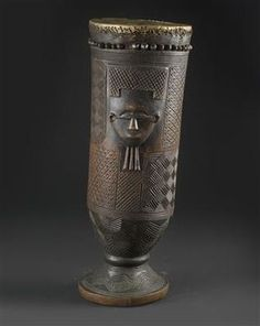 Africa | A drum, single-headed with light skin, stitched and secured with wooden nails. | From the Lele or Kuba people of DR Congo