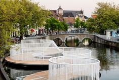 pavilion with playful swings and hammocks floats in a bruges canal, by OBBA and dertien 12 Floating Architecture, Pavilion Architecture, Landscape Architecture, Landscape Design, Interior Architecture, Sustainable Architecture, Urban Landscape, Residential Architecture, Contemporary Architecture
