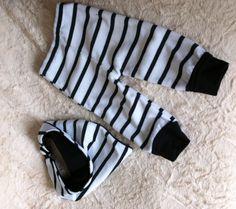 Pantalón y babero bebe, en modal y plush.
