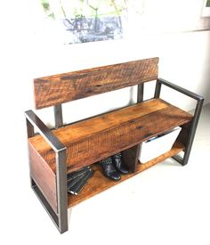 You're home! Have a seat, take your shoes off and enjoy the beauty of your reclaimed wood entryway storage bench. This lovely piece combines the beauty of reclaimed wood with an industrial steel base. It is sure to make a great statement to anyone walking into your home and practical for your everyday life with two storage cubbies!