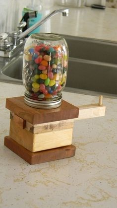 filled the Mason jar with jelly beans, but this candy dispenser would be perfect for Skittles and M&Ms as well.She filled the Mason jar with jelly beans, but this candy dispenser would be perfect for Skittles and M&Ms as well. Kids Woodworking Projects, Wood Projects For Beginners, Learn Woodworking, Wood Working For Beginners, Popular Woodworking, Diy Wood Projects, Woodworking Plans, Woodworking Furniture, Wood Crafts