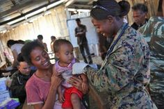 Lieutenant J.G. Francesca Harris, physician assistant, Combat Logistics Battalion 15, 15th Marine Expeditionary Unit, massages a child's arm after administering him a vaccine in a Timor-Leste village, Oct. 11. during Exercise Crocodilo 2012, the first exercise the 15th MEU and Peleliu Amphibious Ready Group has conducted during its Western Pacific deployment...