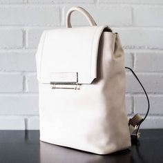 Danielle Nicole Jett Colorblocked Backpack Available now. Made of quality faux leather materials for an ultra soft and durable feel. Front magnetic snap closure. 2 inside pocket plus 1 zip pocket. Adjustable straps for comfort fit. Available in Stone and Black. Danielle Nicole Bags Backpacks