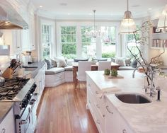 i like this kitchen-light colors, wood, bench with bay window