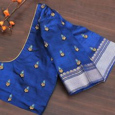 Beautiful embroidery and striking colours have been used in this customized blouse designed by Anya. Customize yours today Beautiful embroidery and striking colours have been used in this customized blouse designed by Anya. Customize yours today Hand Work Blouse Design, Simple Blouse Designs, Stylish Blouse Design, Silk Saree Blouse Designs, Bridal Blouse Designs, Blouse Simple, Aari Work Blouse, Half Saree Designs, Choli Designs