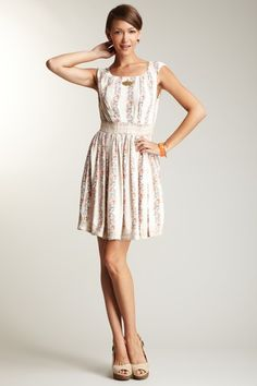 Such a cute, demure, feminine dress.  I love the delicate floral pattern an the lace accents at the hem and waist.