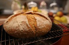 Artisanal Homemade sourdough bread baked in iron cast casserole.  Step5