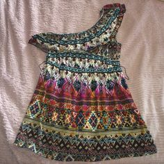 One Shoulder Tribal Pattern Top This cute shirt has a unique pattern and would be great to wear with a pair of jean shorts. The last pic is a picture of a belt loop. (Belt not included) It has been worn. Self Esteem Tops Blouses