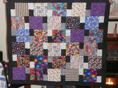 I like the combination of the fun, colorful squares with the black and white rectangle blocks.