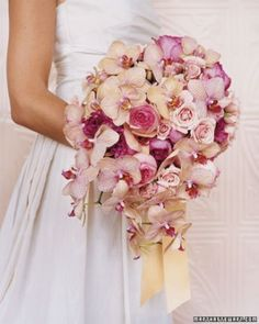 This oversize bouquet of sculpted dahlias and feathery astilbe will bend gracefully over the arm. Silk shantung covers the stems while vintage crystals dangle from a free-form bow.