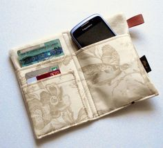 iPhone wallet, cell phone wallet, iPhone 4 wallet, iPod case, linen iPhone wallet, linen cell phone case, natural birds toile fabric. $25.00, via Etsy.