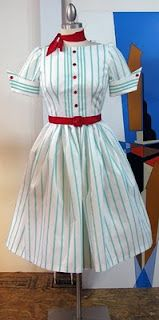 I'm not super fond of the stripes, but I really like the cut of the dress and the read scarf & belt.