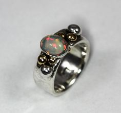 Hey, I found this really awesome Etsy listing at https://www.etsy.com/listing/606349069/her-glowing-rainbow-welo-opal-ring-set