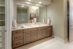 Design by: Carrie Hoffman, Superior Cabinets Calgary; Builder: Augusta Fine Homes Calgary; Cabinet Finish: Tungsten Doorstyle: Maple Windsor #bathroom #double #sink