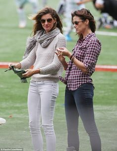 Gisele and Bridget: Mature: Proving their relationship is anything but catty, the 5ft11 supermodel and the 5ft10in actress happily bonded on the field while clad in similar skinny jeans