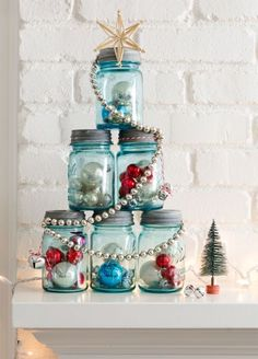 This idea's perfect for a mantel or entry table. Fill six like-sized canning jars with ornaments, tinsel, greenery, you name it. Assemble the jars in a pyramid, then wrap it with a shiny garland and top with a star. Done!