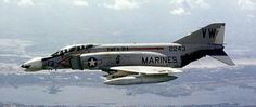A U.S. Marine F-4B Phantom II of fighter-attack squadron VMFA-314, the Black Knights, flying over South Vietnam in September 1968.