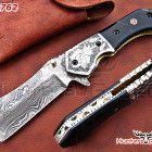 Damascus custom handmade folding/hunting knife with bull horn handle.