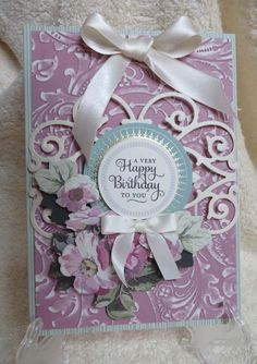 Made this card using the Anna Griffin Acanthus Cuttlebug folder, flowers from the 20th Anniversary collection, and one of the Cuttlebug die cuts.