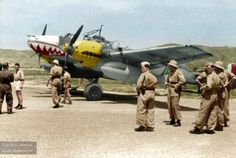 "Luftwaffe's Messerschmitt Bf 110 with Iraqi markings at Tatoi Airfield, Athens, on May 14, 1941, likely during a stop of ferry flight to Mosul, Iraq, via French Syria. The aircraft, with the nose dressed with the ""shark teeth"" markings of his unit, is one of Bf 110 of the 4. Staffel/ZG 76 assigned to Fliegerführer Irak, the German Air Command committed for the Axis support of the unsuccessful Iraqi uprising against the Great Britain."