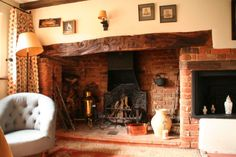 18th century country cottage with inglenook fireplaces, an old style aga and pretty gardens