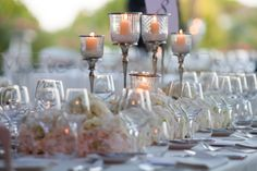 High candle holders will bring elegance to your tables. At night, it just looks gorgeous! Wedding by Monte-Carlo Weddings