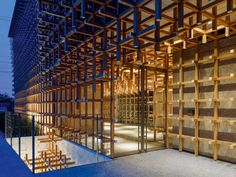 A striking facade with a wooden grid clads the GC Prostho Museum Research Center in Kasugai, Japan. Kengo Kuma, Timber Screens, Viborg, Community Library, High Building, National Stadium, Research Centre, Aichi, Time Magazine