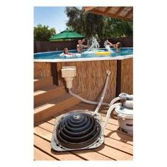 Black Mesh Pool Fence With White Poles Installed In Grass